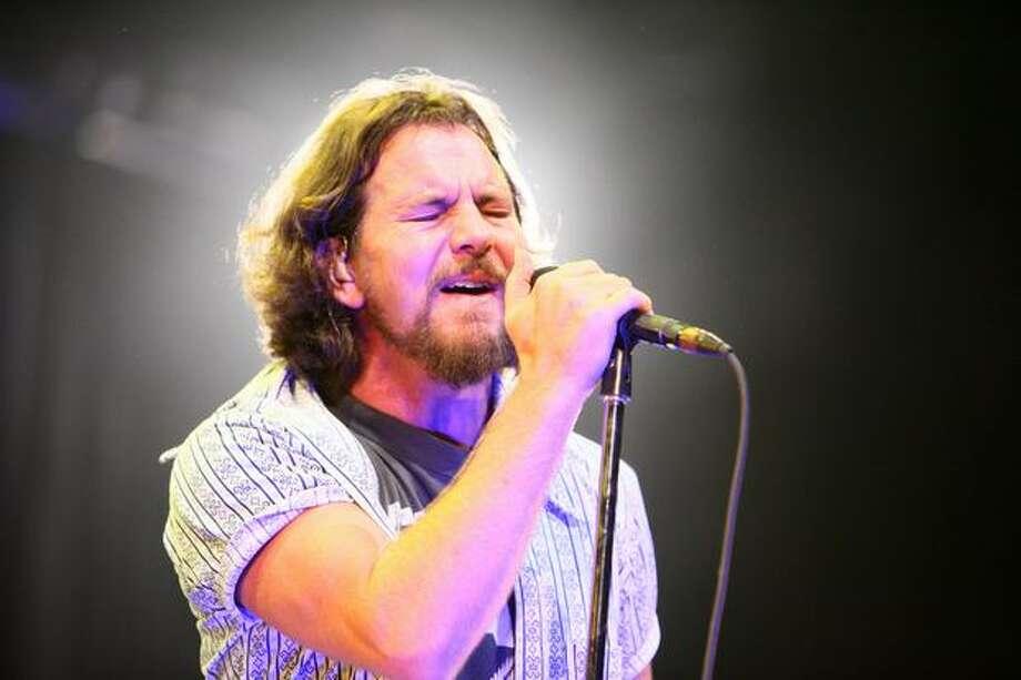 Eddie Vedder of Seattle rock band Pearl Jam performs at Key Arena during band's world tour kickoff. Photo: Joshua Trujillo, Seattlepi.com / seattlepi.com