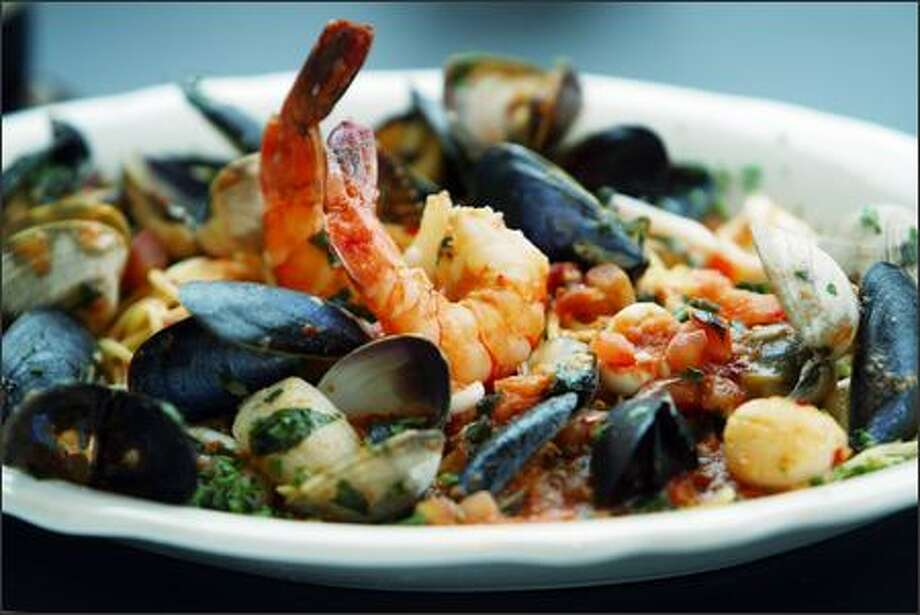 Scallops, prawns, mussels, clams and calamari are simmered in a tomato broth for Cioppino ($18) at Gaspare's, where owner Gaspare Trani still runs a one-man kitchen. Photo: Gilbert W. Arias, Seattle Post-Intelligencer / Seattle Post-Intelligencer