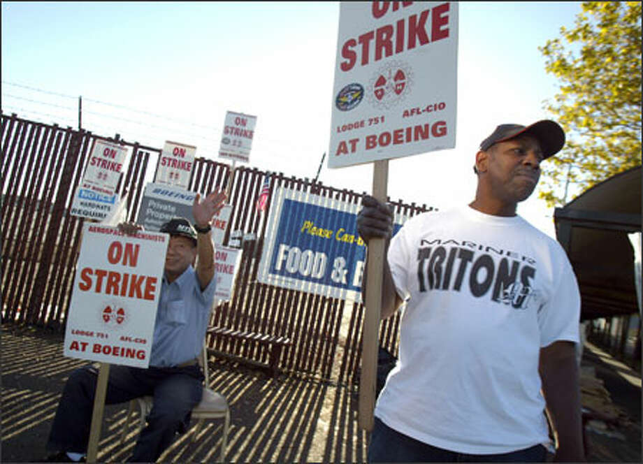 """Machinists Khoa Ho, left, and James Lofton picket at Boeing's Renton facility Sunday. """"This strike is over,"""" one Machinist said after hearing of the pact. Photo: Joshua Trujillo, Seattlepi.com / Seattle Post-Intelligencer"""