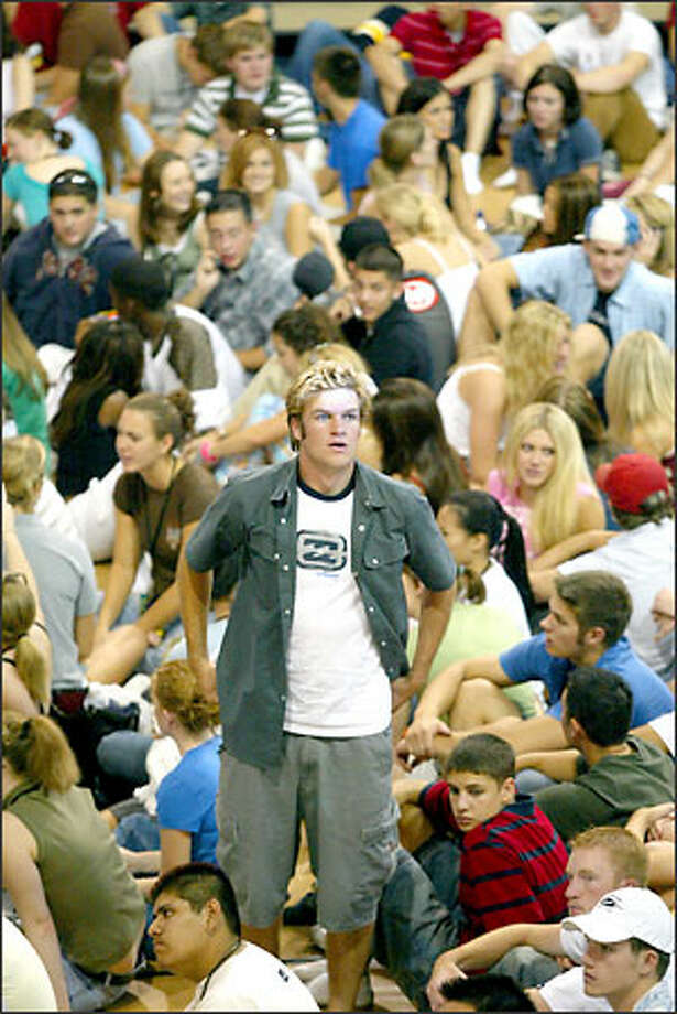 Hunter Volk, a University of Washington freshman from California, looks around a crowded Edmundson Pavillion during freshmen and transfer student orientation at the University of Washington in Seattle on Thursday, September 25, 2003.  Nearly 6,000 students were expected to attend the mass orientation, the largest single orientation at the UW, according to organizers. Photo: Joshua Trujillo, Seattlepi.com / seattlepi.com