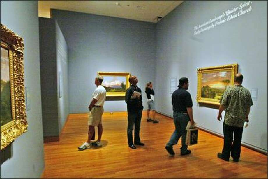 "Visitors check out Seattle Art Museum's exhibit ""Quieter Spirit: Early Paintings by Frederic Edwin Church,"" curated by Patricia Junker. Photo: Grant M. Haller, Seattle Post-Intelligencer / Seattle Post-Intelligencer"