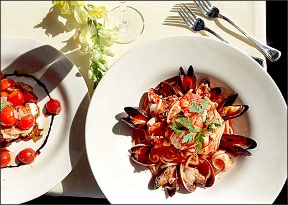 Among the specialties at Vivanda Ristorante on Pine Street is the Linguine Melange, right, and an appetizer called Mozzarella and Tomato Salad. Photo: Scott Eklund, Seattle Post-Intelligencer / Seattle Post-Intelligencer