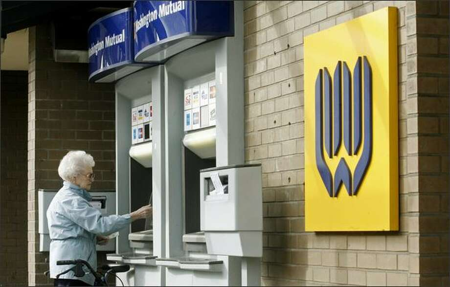 Long-time Washington Mutual customer Mary Murray, 90, withdrawals money from an ATM outside a WaMu branch in Seattle's Ballard neighborhood on Friday. Photo: Dan DeLong, Seattle Post-Intelligencer / Seattle Post-Intelligencer