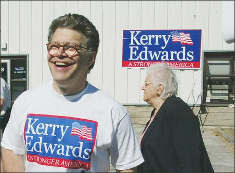 Comedian and radio talk show host Al Franken speaks with a supporter outside the 'Kerry for President' campaign office in Portland, Maine. (AP Photo/Joel Page) Photo: Associated Press / Associated Press