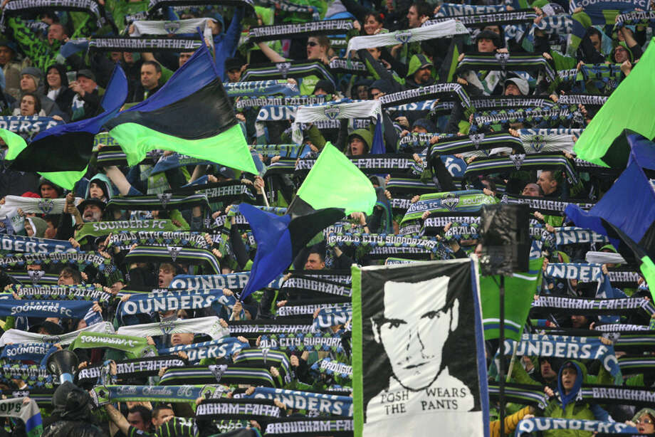 Seattle Sounders fans hold up their scarves during the MLS season opener against the L.A. Galaxy on Tuesday, March 15, 2011 at Qwest Field in Seattle. Photo: Joshua Trujillo / Seattlepi.com
