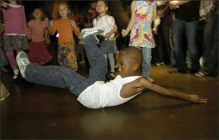 "Kenneth Green, 4 1/2, shows off his style during the ""Best Little Dancer in America"" contest Saturday at the Baby Loves Disco party at Club Heaven. Kenneth captured the 4-to- 7-year-old category. Photo: Julie Graber, Special To The Seattle Post-Intelligencer / Special to the Seattle Post-Intelligencer"