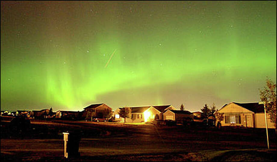The northern lights dance in the sky over Kalispell, Mont. Photo: Associated Press / Associated Press