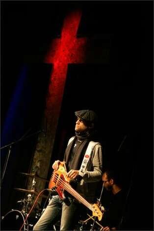 Craig Curran, bass player for church band BCG, pauses