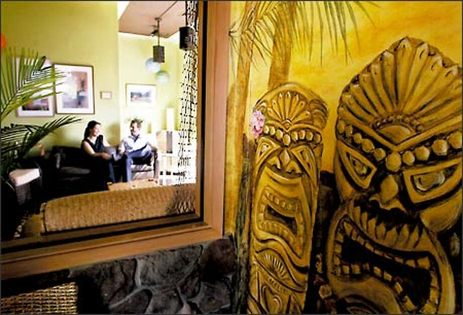 The Islander Polynesian Cuisine and Tiki Lounge in downtown Seattle is elegantly kitschy in its design. Photo: Meryl Schenker, Seattle Post-Intelligencer / Seattle Post-Intelligencer