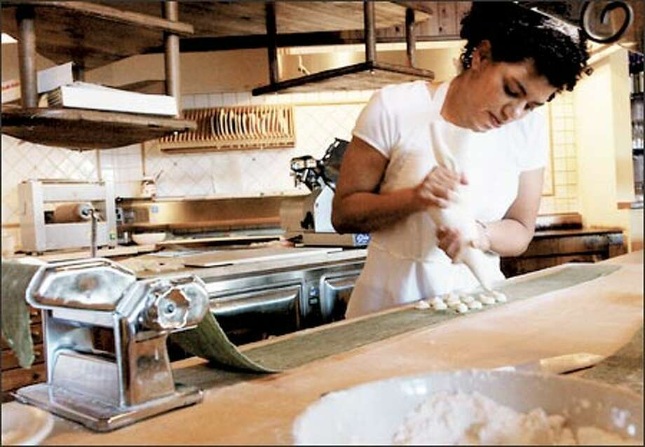 Part owner Sachia Tinsley makes up a batch of Tortelli Verdi ai Formaggi, filled ravioli with four cheeses, at the casual Capitol Hill eatery Osteria la Spiga. Photo: Jeff Larsen, Seattle Post-Intelligencer / Seattle Post-Intelligencer