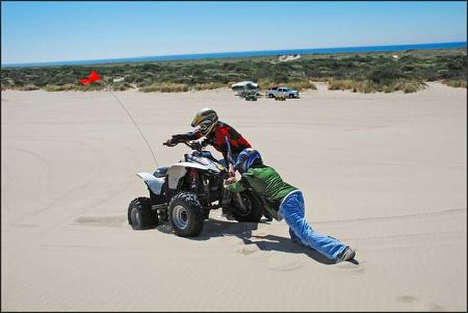 Just because you're riding an ATV doesn't mean you can't get stuck. Hint: Where there are tracks, there's usually traction. Photo: Deston Nokes, Special To The P-I / Special to the P-I