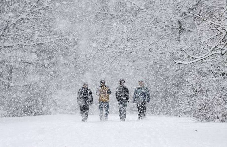 Heavy snow, coming down in large flakes, obscures visitors as they walk in the Washington Park Arboretum in Seattle in this December 2008 file photo. (Seattle Post-Intelligencer/Dan DeLong) Photo: P-I File / P-I File