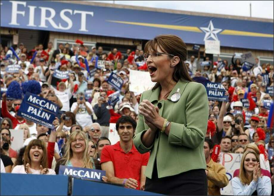 Republican vice presidential candidate, Alaska Gov. Sarah Palin, greets supporters after a rally in Carson, Calif., on Saturday. Photo: Associated Press / Associated Press
