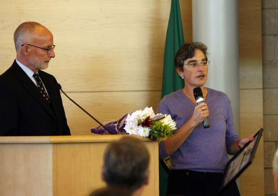 "Merril Cousin, executive director of the King County Coalition Against Domestic Violence, was among those who received awards Tuesday at Seattle City Hall during a ceremony that was part of Domestic Violence Awareness Month. City Councilman Tim Burgess, left, said the council ""will be taking very strong steps"" to restore funding for domestic violence programs. Photo: Casey McNerthney, Seattlepi.com / seattlepi.com"