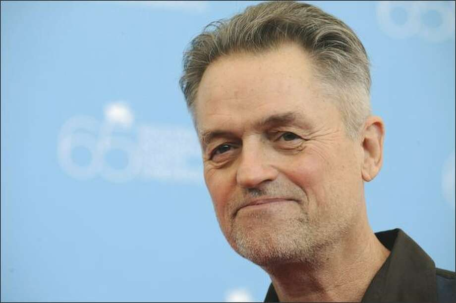"Director Jonathan Demme poses during the photocall for the movie ""Rachel Getting Married"" at the 65th Venice International Film Festival at Venice Lido on Sept. 3, 2008. (Damien Meyer/AFP/Getty Images)"