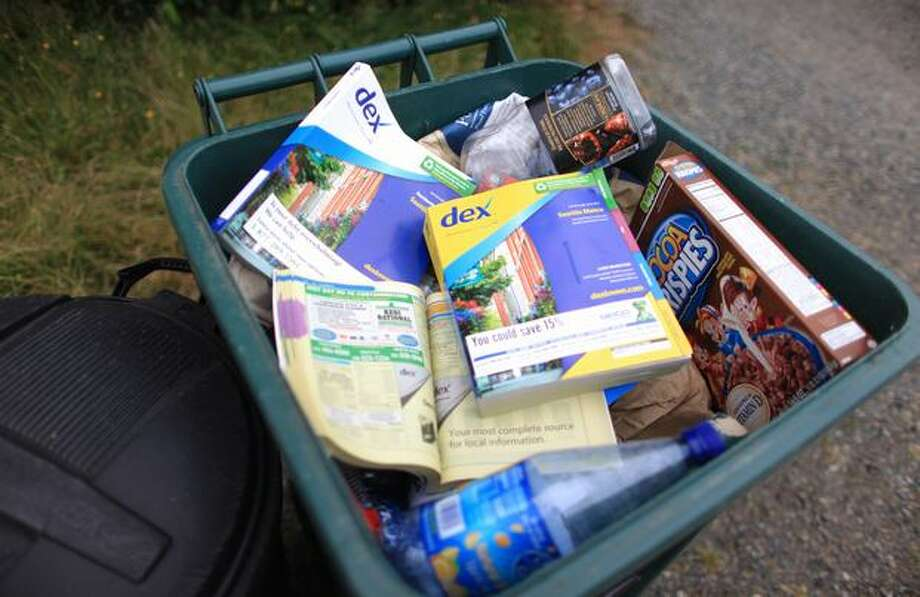 Phone books sit in a recycle bin at a home in this July 2010 file photo. An effort is under way to limit delivery of unwanted phonebooks in Seattle. Photo: Joshua Trujillo, Seattlepi.com / seattlepi.com