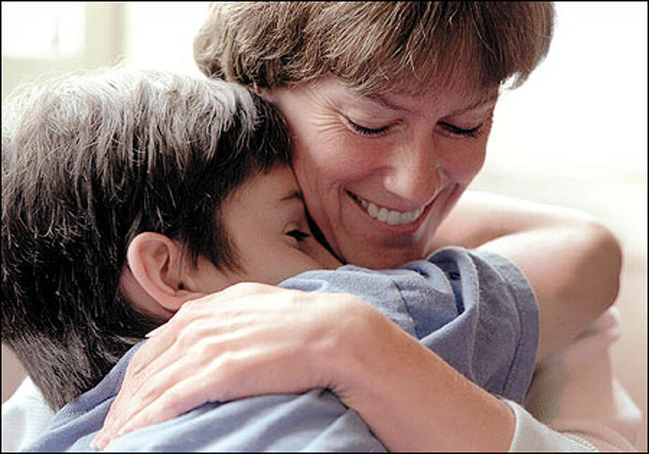 A big hug from mom brings Sean Hegarty much comfort. The death of his father two years ago has drawn him even closer to his mother. Photo: Meryl Schenker, Seattle Post-Intelligencer / Seattle Post-Intelligencer