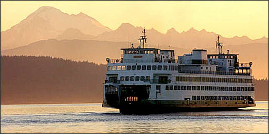 A Washington State ferry leaves Anacortes, Wash., in route to Orcas Island, Friday Harbor and Sidney, British Columbia, Wednesday morning. Mount Baker is seen in the background. Photo: Associated Press / Associated Press