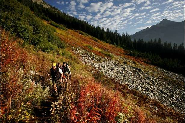 "For wide-open slopes of fall colors, the Maple Pass Loop Trail is hard to beat. Says one fan of the trail, ""That's my idea of what heaven would look like."" The 7.5-mile loop begins at Rainy Pass on the North Cascades Highway."
