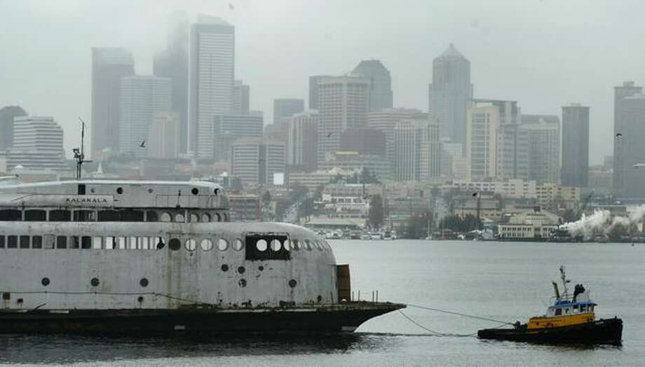 The 1930s-era art deco ferry Kalakala sets sail from Seattle's Lake Union for a trip to Neah Bay in this 2004 file photo. The vessel later moved to Tacoma, where it is berthed today. Photo: Joshua Trujillo, Seattlepi.com / seattlepi.com