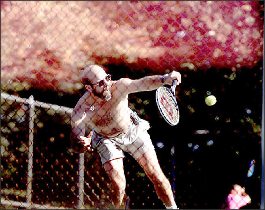 Rich Johnson, a zookeeper at Point Defiance Zoo in Tacoma, takes his lunch break yesterday to knock the tennis ball around and work on his fall tan at the Point Defiance courts. The temperature hit 72 degrees in Tacoma and should continue in the high 60s or low 70s around the area today before clouds move in over the weekend. Photo: Scott Eklund, Seattle Post-Intelligencer / Seattle Post-Intelligencer