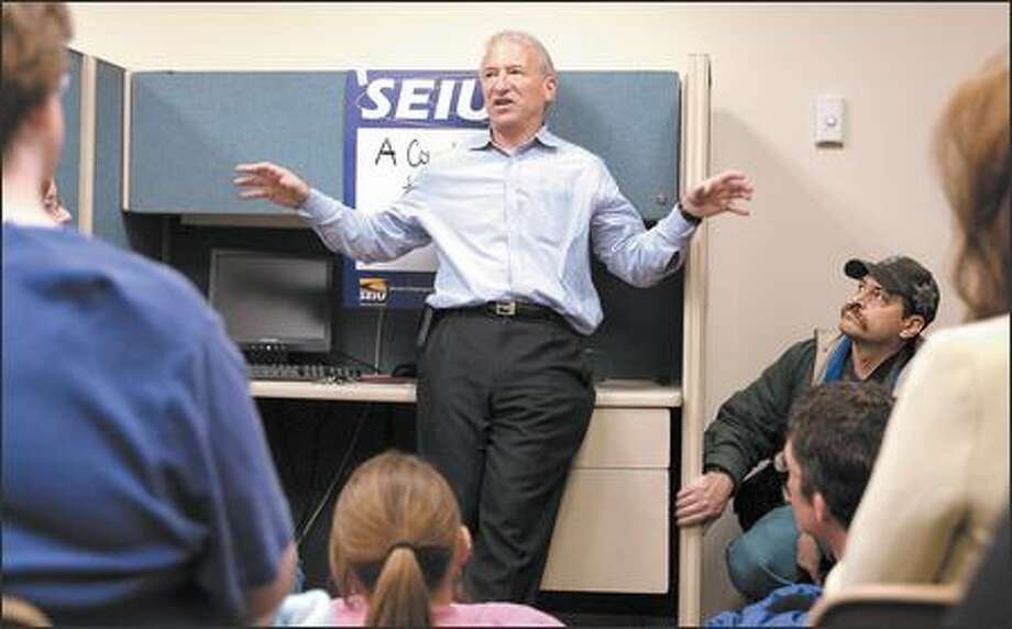 "Andy Stern, head of the Service Employees International Union, talks about his new book, ""A Country That Works,"" with a group at UFCW Local 21 in Seattle on Monday. Photo: Gilbert W. Arias, Seattle Post-Intelligencer / Seattle Post-Intelligencer"
