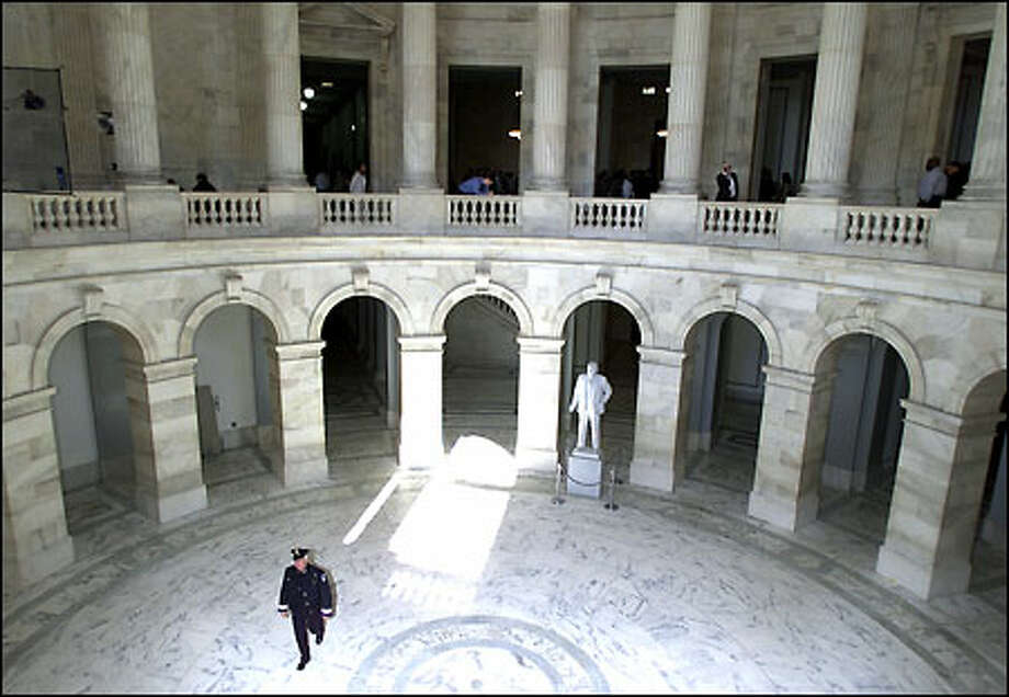 A Capitol police officer walks through a part of the Russell Senate office building after congressional leaders shut down the House yesterday. Photo: Associated Press / Associated Press