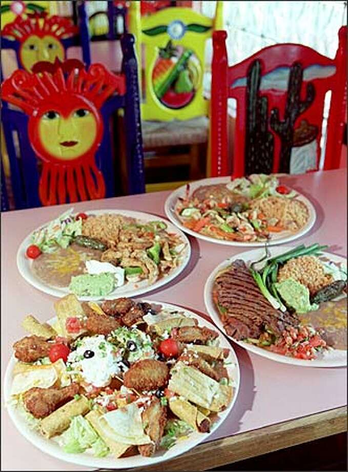 Maya's menu offers a diner many savory choices. Above, clockwise from top right, are Camarones al Mojo de Ajo, Carne Asada, Bocadito Sampler and chicken carnitas.