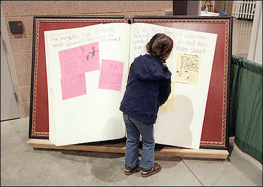 Budding writers were able to contribute their stories to a giant book at last year's Bookfest. This year, organizers say there will be expanded programming for teens and young readers. Photo: Seattle Post-Intelligencer / Seattle Post-Intelligencer