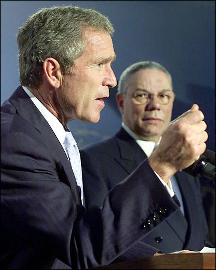 President Bush speaks in Shanghai, China, yesterday. Colin Powell is at right. Photo: Associated Press / Associated Press