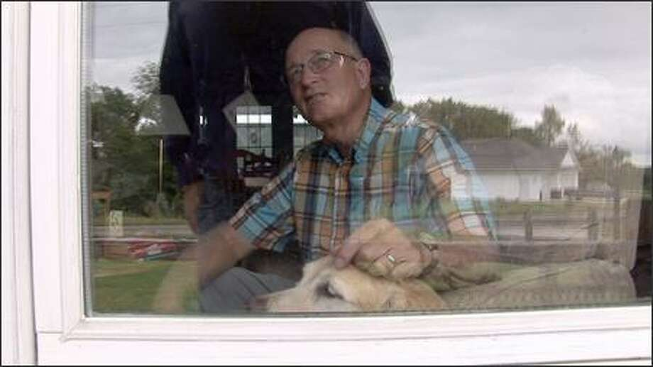 Gary C. Lindsey, a former school teacher accused of sexually abusing several of his students, appears with his dog in this image from video made at his home outside Cedar Rapids, Iowa. Lindsey, 68, was never charged with a crime related to the allegations. He did, however, surrender his Iowa teaching license in 2004 after a former student who'd accused him of inappropriate touching successfully sued the Cedar Rapids schools and then filed a complaint with the state. (AP Photo/Mark Carlson) Photo: Associated Press / Associated Press