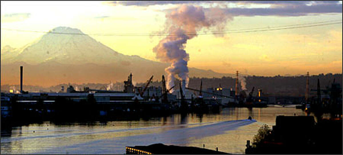 Steam rises from plants along the Duwamish River.