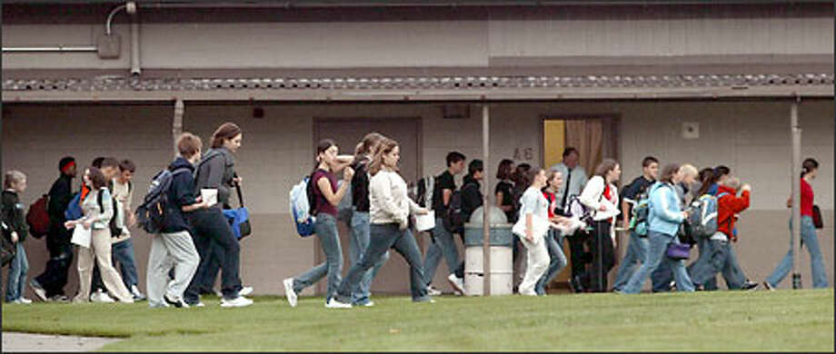 After getting class assignments, students hurry to their first class at Marysville Junior High School. After a 51-day teachers strike, Wednesday was the first day of the school year for Marysville public school students. Photo: Grant M. Haller, Seattle Post-Intelligencer / Seattle Post-Intelligencer