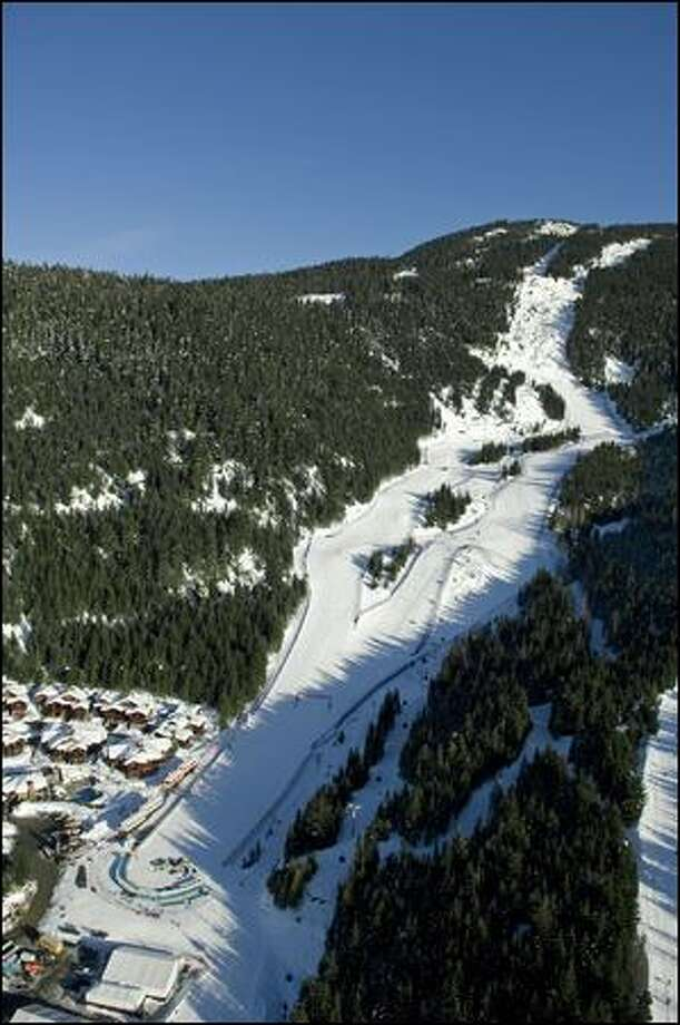 The downhill ski course at Whistler Blackcomb, which hosted the 2010 Winter Olympics.  The busiest ski resort in North America, it boasts drops of more than 4,000 vertical feet.  The U.S.-based Vail Resorts is buying Whistler-Blackcomb in a billion-dollar deal.  (Whistler Blackcomb)