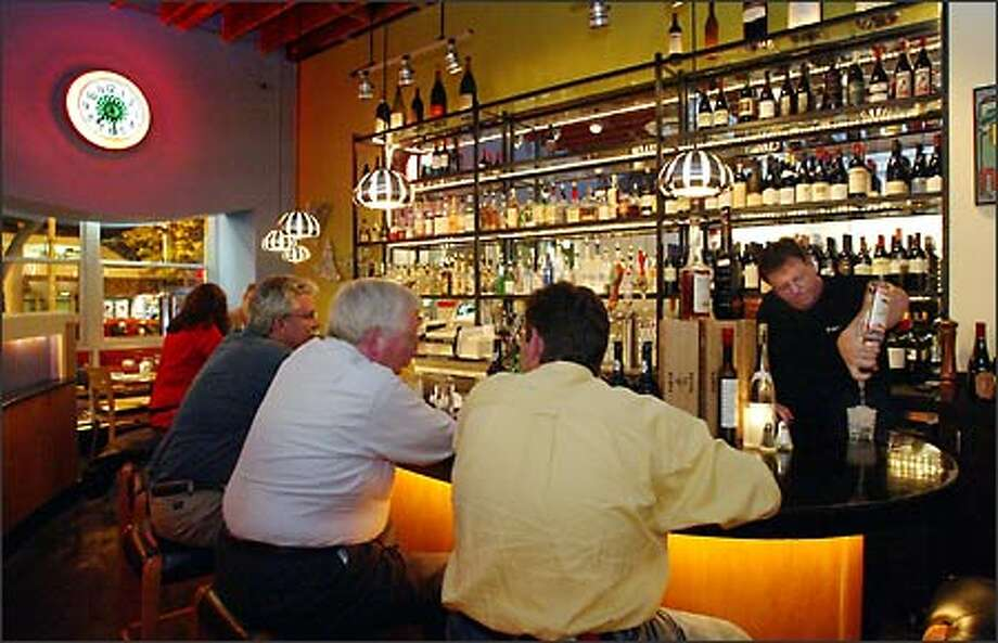 Regulars belly up to the bar while owner John Sillers mixes a drink at the Market Street Urban Grill in Ballard. Photo: Gilbert W. Arias, Seattle Post-Intelligencer / Seattle Post-Intelligencer