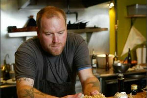 Matt Dillon, owner of Sitka & Spruce, prepares to cook Faber's cauliflower mushroom. Dillon has been named one of the country's top new chefs.