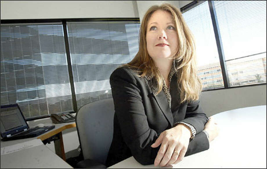 "Kathleen Hayes, marketing vice president at San Mateo, Calif., software company BlueRoads, found her job at LinkedIn, an online networking service. ""It's all about trust,"" said Hayes, 41. ""The best way to get a meeting usually is through a friend, so this is definitely a viable service."" Photo: Associated Press / AP"