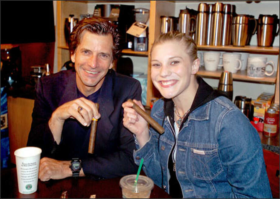 "The old and new ""Battlestar Galactica"" Starbucks -- Dirk Benedict, left, and Katee Sackhoff -- sit down at a certain chain coffeehouse. Photo: Sci-Fi Channel / Caption -"