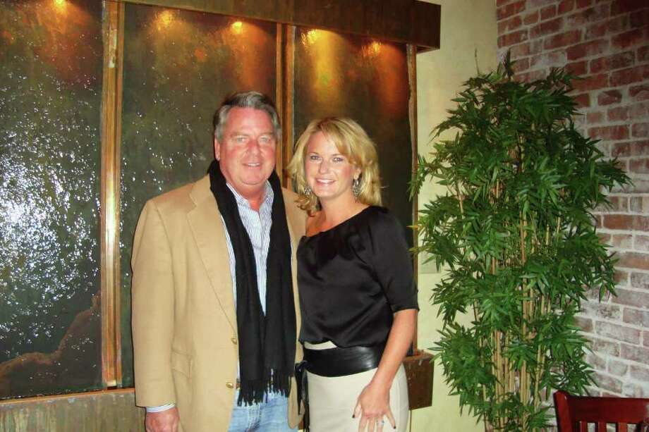 Arnie d'Angelo and his girlfriend Stephanie in front of the new water feature in the dining room of Bacchus. Photo: Contributed Photo / Wendy Logan, Contributed Photo / Norwalk Citizen