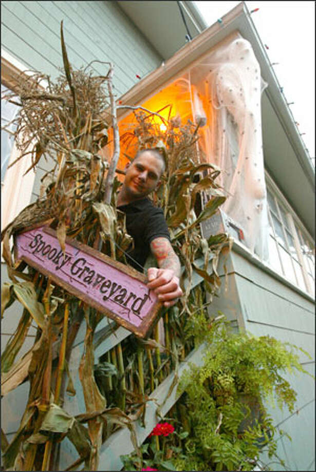 Krhounek, 29, figures he's spent $10,000 over the years on decor and costumes, and he's ready to shell out more. Photo: Grant M. Haller, Seattle Post-Intelligencer / Seattle Post-Intelligencer