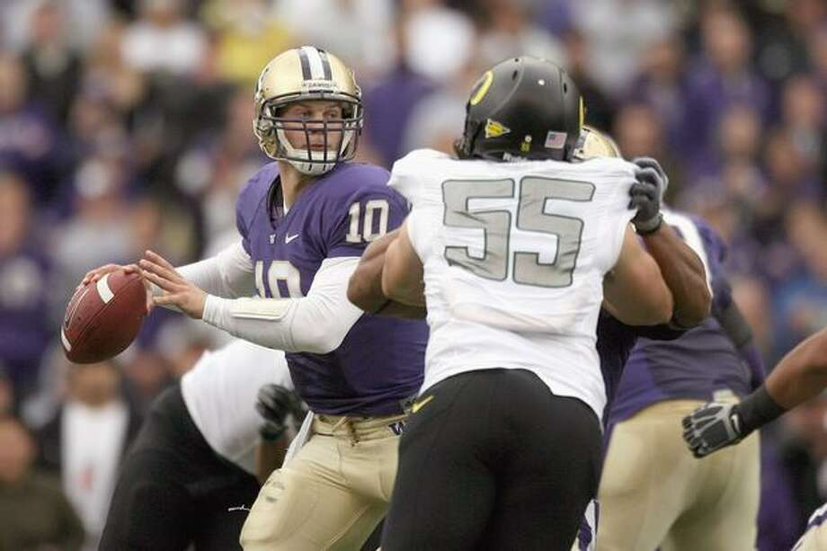 UW quarterback Jake Locker looks to pass against the Oregon Ducks during Saturday's 43-19 loss. Photo: Getty Images / Getty Images
