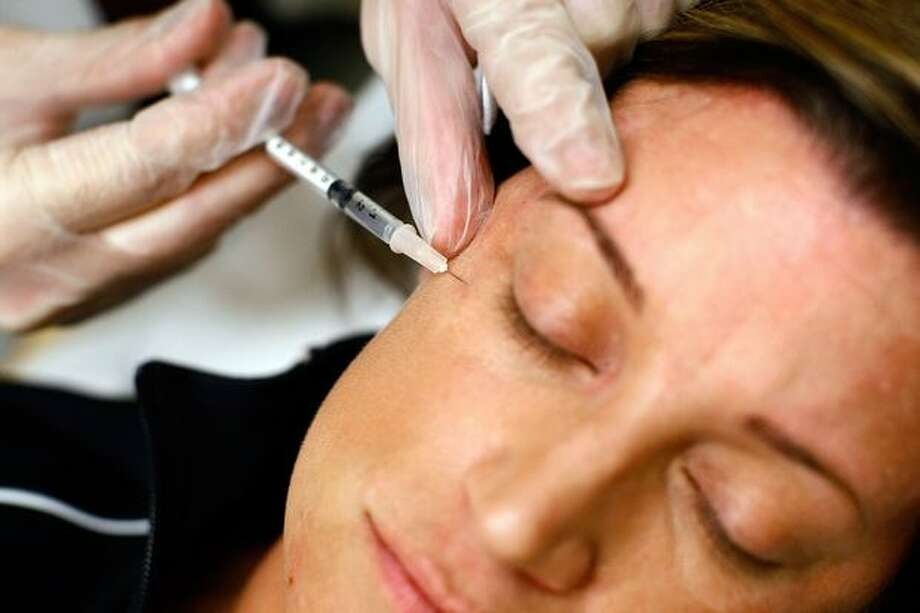 In this June 2009 file photo, a woman receives a Botox injection in Arlington, Va. Photo: Getty Images / Getty Images