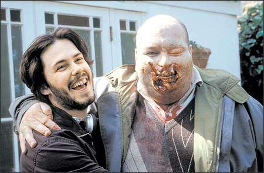 "The movies' focus on zombies took a comedic twist with the 2004 British film ""Shaun of the Dead."" Here director Edgar Wright poses with one of his zombies. Photo: Rogue Pictures / Rogue Pictures"