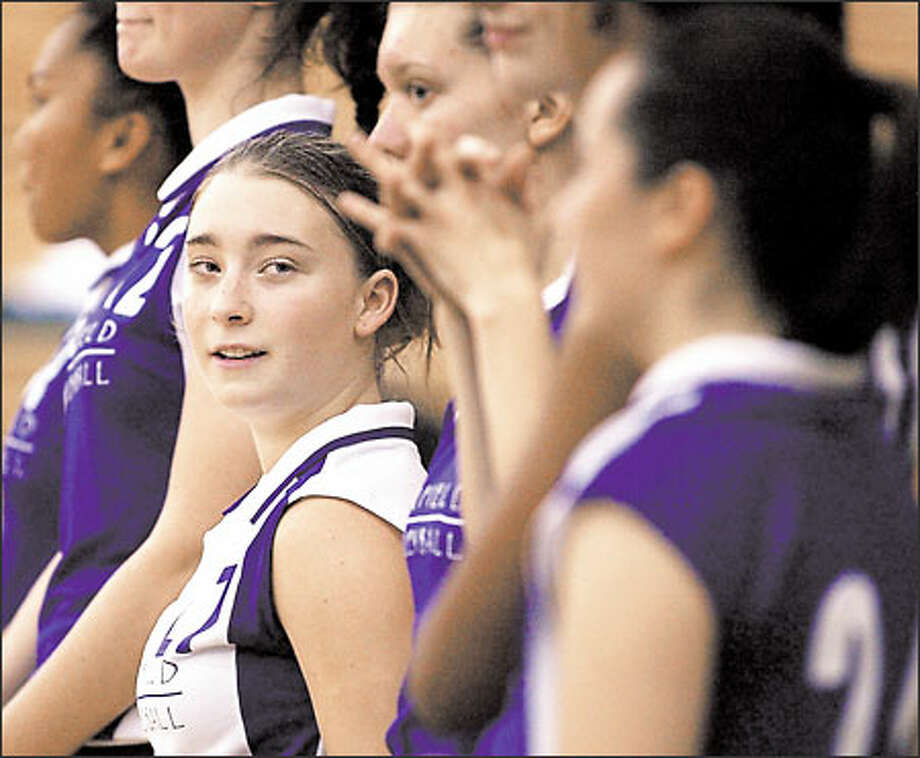 Garfield High junior Amanda Jamieson stands with teammates before a recent match. Jamieson plays libero, a position introduced this season. Photo: Gilbert W. Arias, Seattle Post-Intelligencer / Seattle Post-Intelligencer