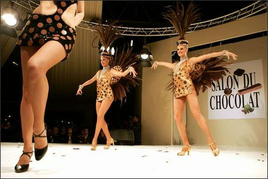 This would seem to be a definition of confection: Bluebell girls from the Lido, the racy cabaret on the Champs-Elysees, present edible costumes during the chocolate dress fashion show at the 12th World Chocolate Fair Friday in Paris. Photo: Associated Press / Associated Press