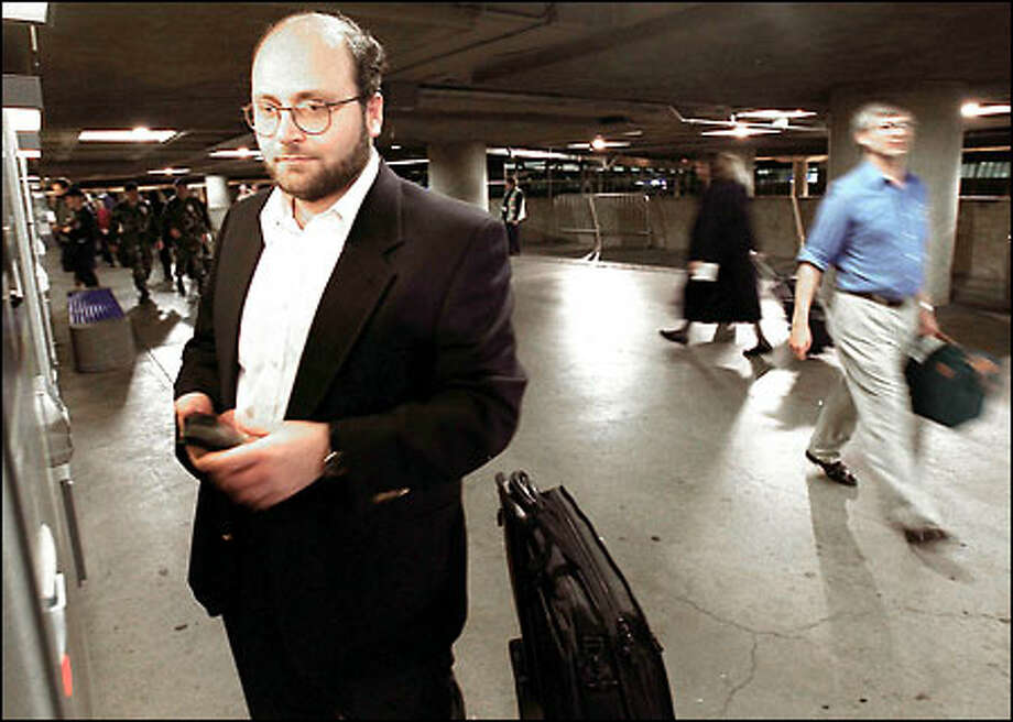 Ahmad Hashem, a manager at Microsoft, pays for parking at Sea-Tac Airport last night after a flight from San Diego. The Syrian American is keeping a low profile. Photo: Jeff Larsen, Seattle Post-Intelligencer / Seattle Post-Intelligencer