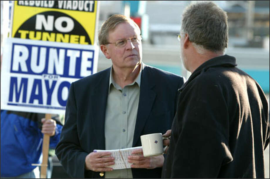 Al Runte, left, talks with supporter Mike Clay when the mayoral candidate was campaigning recently in West Seattle. Photo: Gilbert W. Arias, Seattle Post-Intelligencer / Seattle Post-Intelligencer