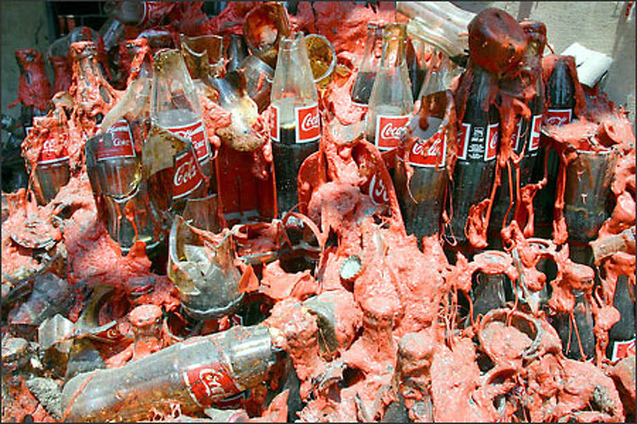 Bottles of cola are embedded in melted plastic within the damaged storage room of a nightclub in Bali, Indonesia. The Oct. 12 explosions on the resort island killed nearly 200 people, mostly foreign tourists. Photo: Associated Press / Associated Press