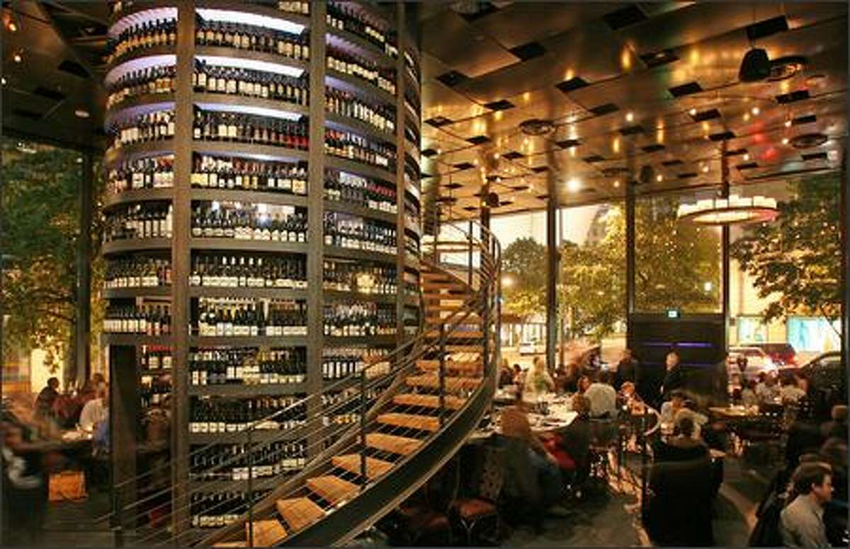 Purple Cafe and Wine Bar's wine tower reaches from floor to ceiling. Keep clicking for all the info on Seattle's other priciest eats on the cheap.
