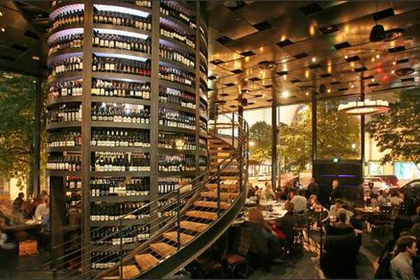 Purple Cafe and Wine Bar's wine tower reaches from floor to ceiling. The 5,000-bottle tower is used only for popular by-the-glass servings. The wine list encompasses some 300 bottles, more than 75 glasses and pages of selected flights.